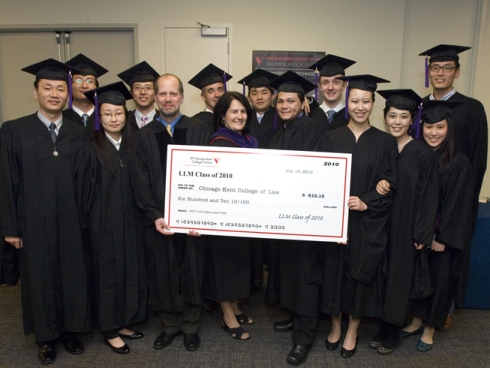 The LL.M. graduates presented a check to Dean Harold J. Krent And Dean Lydia Lazar in the robing room prior to the Commencement Ceremony.